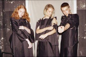 Three models dressed in black